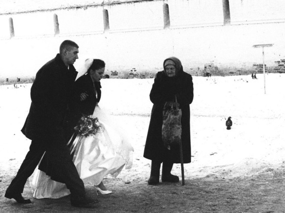 Bride, beggar and bird