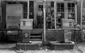 Men on Gas Station Porch 1973