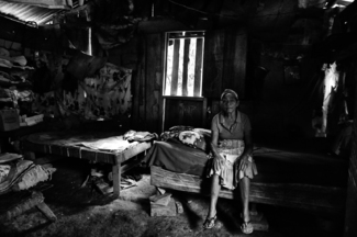 Martiane Sitting on her Bed, The Last Mile, Honduras