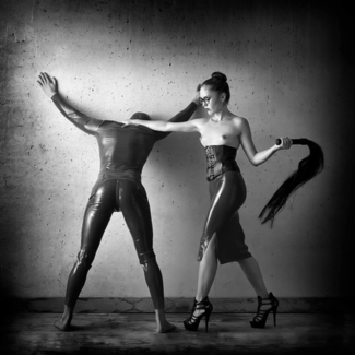 the mistress wipping her slave
