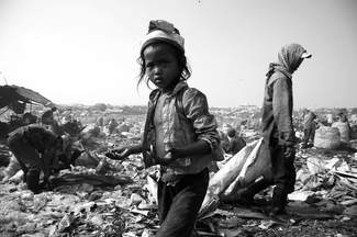 Little Girl Working in Rubbish