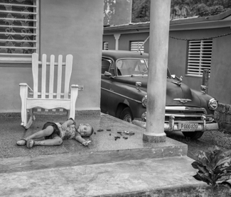 Cuban Child Playing on his Porch
