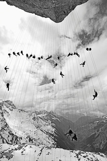 Climbers hanging on ropes