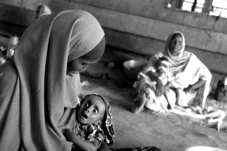 Mother with her daughter who suffers from malnutrition at the hospital inside IFO refugee camp.