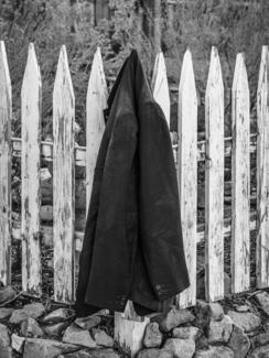 Jacket on a White Picket Fence
