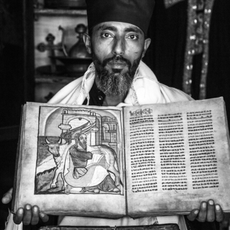 Priest with Bible at Azua Maryam Monastery