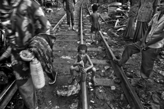 Child Labor - Living by the Railroad Track