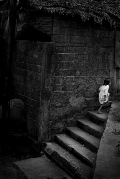 streetchild running stairs