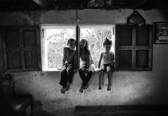 Three Little Children Sat in a Window