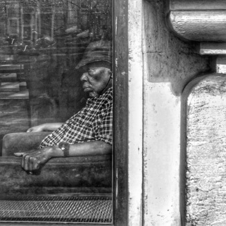 Man Behind Window