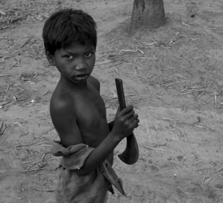 Santhal boy with sickle