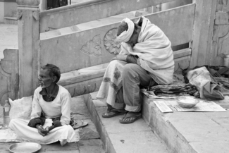Beggars at the Ganges river, India