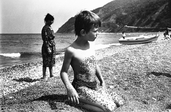 Boy and Pebbles on Beach
