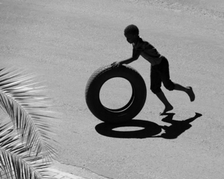The Boy with the Tyre