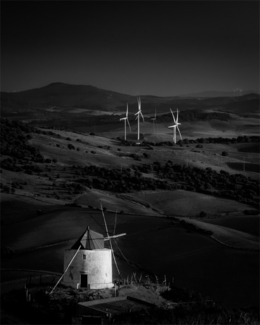 Quixotic old Spanish windmill, sizing up his enemy