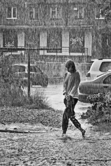 In the rain, one girl