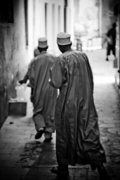 answering the call to prayer, stonetown, zanzibar