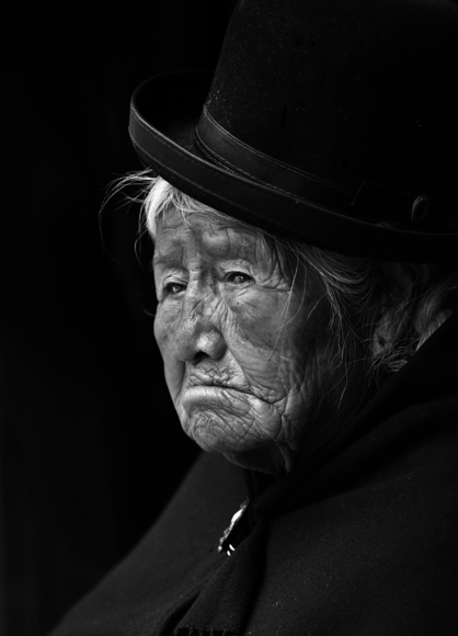 Sad Lady in bowler hat