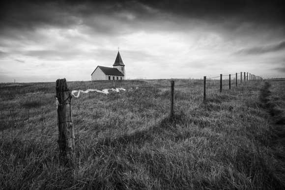 Fence And White Church, Iceland